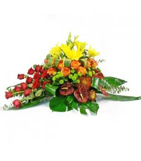 Coixí flor variada i roses taronjes